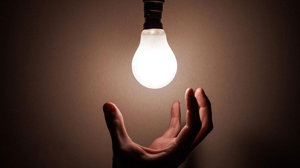 hand reaching for a light bulb